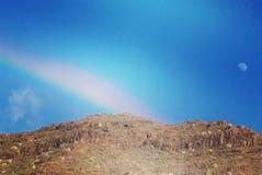 Rainbow and moon stock photo