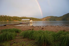 Rainbow on mountain lake Royalty Free Stock Image