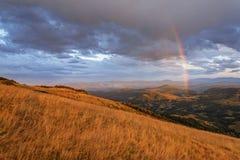 Rainbow on mountain landscape Stock Image