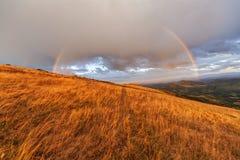 Rainbow on mountain landscape Royalty Free Stock Photos