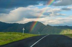 Rainbow mountain road field Stock Photos
