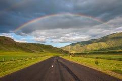 Rainbow mountain road field Stock Image
