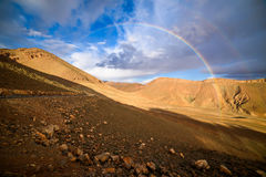 Rainbow on a mountain road in High Atlas in Morocco. Mountain road in High Atlas with two rainbows, Morocco Stock Photography
