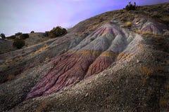 Rainbow Mountain in Utah, near Moab and Cleveland. Colorful Jurassic rock formation near Cleveland-Lloyd Dinosaur Quarry. Utah. United States Stock Photos