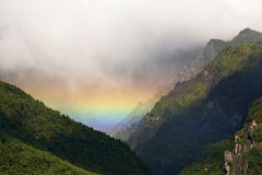 Rainbow in Mountain Valley Stock Image