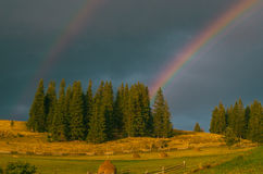 Rainbow in the mountain valley after rain. Beautiful landscape in Carpathians. Ukraine Stock Image