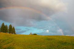 Rainbow in the mountain valley after rain. Beautiful landscape in Carpathians. Ukraine Stock Photography