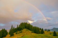 Rainbow in the mountain valley after rain. Beautiful landscape in Carpathians. Ukraine Stock Photo