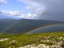 Rainbow in mountains Royalty Free Stock Photo