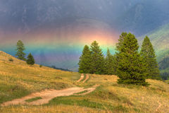 Rainbow in mountains. Beautiful rainbow in the mountains Royalty Free Stock Images