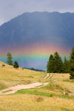Rainbow in mountains. Beautiful rainbow in the mountains Royalty Free Stock Photos