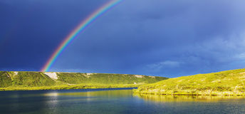 Rainbow in mountains Stock Photography