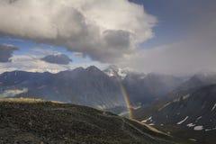 Rainbow in the  mountains Stock Photos