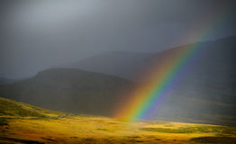Rainbow in the mountains. Rainbow in a mountain landscape in Norway stock photos