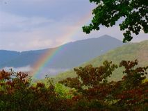 Rainbow in the Mountains royalty free stock photography