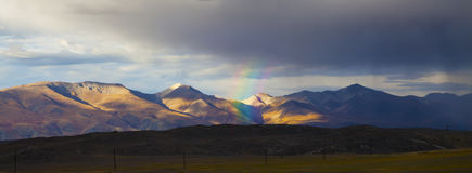 Rainbow in the mountains panorama Stock Photo