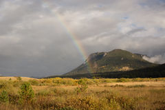Rainbow in the mountains Stock Images