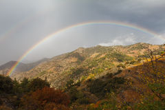 Rainbow in the mountings. Sunshin and rain alternated quick and it was good chance to made the image Stock Image