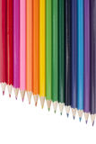 A rainbow of multicolored pencils on a white background.  Royalty Free Stock Images