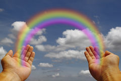 Rainbow in my hand. A rainbow bridging the divide stock photos