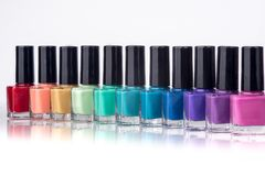 Rainbow of nail polish. On a white background Stock Photography