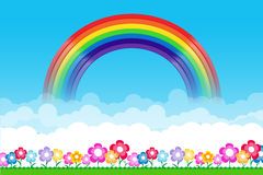 Rainbow on Nature background with green grass and flowers and bl Stock Image