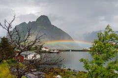 Rainbow near the great mountain on Lofoten islands Royalty Free Stock Image