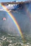 Rainbow near tourist boat at Niagara Falls. Royalty Free Stock Photography