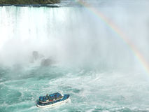 Rainbow near tourist boat at Niagara Falls Royalty Free Stock Photography