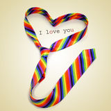 A rainbow necktie forming a heart and the text I love you, with Royalty Free Stock Photography
