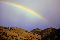 Rainbow and New Mexico Hills Royalty Free Stock Images