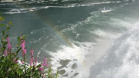 Rainbow at Niagara Falls. Beautiful rainbow caught atop the Niagara falls with the maid of the mist in the distance Royalty Free Stock Image