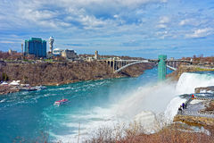 Rainbow in Niagara Falls and Rainbow Bridge across Niagara River Stock Images
