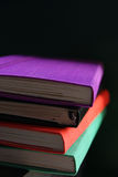Rainbow Notebook Stack. A pile of multicoloured, silk-backed notebooks and sketchbooks Royalty Free Stock Photography