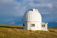 Rainbow and observatory dome in the Gerlitzen Apls in Austria. Royalty Free Stock Photography