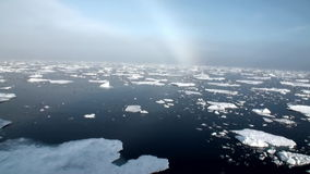 Rainbow in ocean among icebergs and ice in Arctic. Rainbow in the ocean among the icebergs and ice in the Arctic. Fantastic wonderful amazing video grenland stock video footage
