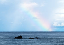 Rainbow in the ocean Stock Images