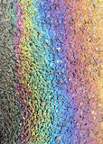 Rainbow Oil Slick on a Road Royalty Free Stock Image