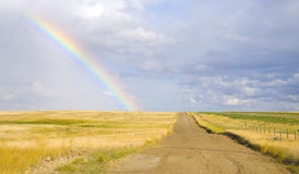 Rainbow On A Country Road Stock Photo