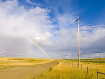 Rainbow On A Country Road Stock Photos
