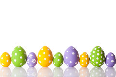 Rainbow order easter eggs in a row Royalty Free Stock Images