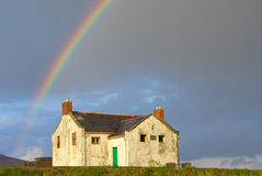 Rainbow over abandoned house. In County Mayo, Ireland stock image