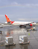 Rainbow over Air India airplane. Stock Image