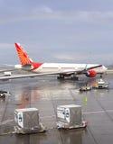 Rainbow over Air India airplane. Stock Image