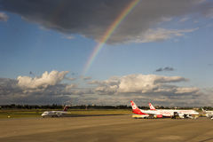 Rainbow over airplanes on airport Royalty Free Stock Image