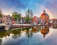 Rainbow over Amsterdam church Koepelkerk, Netherlands.  stock photography