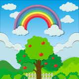 Rainbow over the apple tree Stock Photo