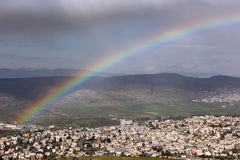 Rainbow over the Arab village Stock Images
