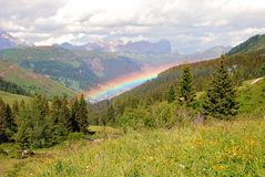 Rainbow over Arabba, Dolomites. Rainbow over Arabba, village in the hearth of Dolomites mountains, Italy Stock Images