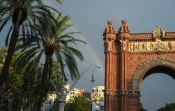 Modern city landscape. Rainbow over the Arc de Triomphe in Barcelona Stock Photography
